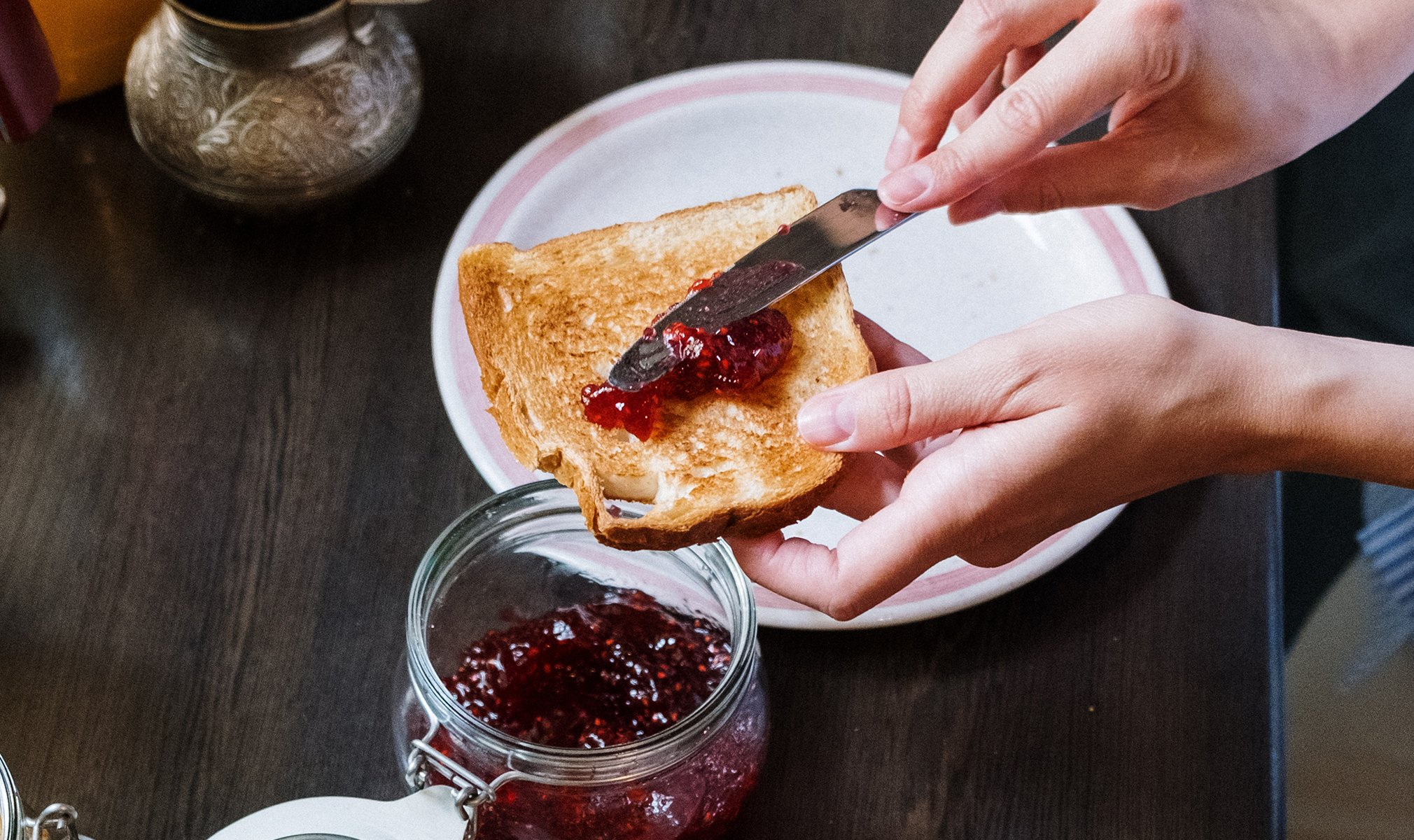 A piece of bread with jam in it