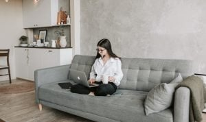 A woman sitting down alone
