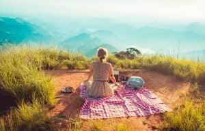 a woman sitting down on a peak